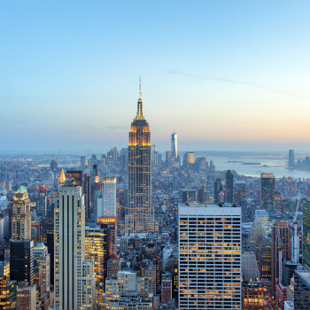 Manhattan-panorama-with-its-skyscrapers-illuminated-at-dusk,-New-York-000058772392_XXXLarge