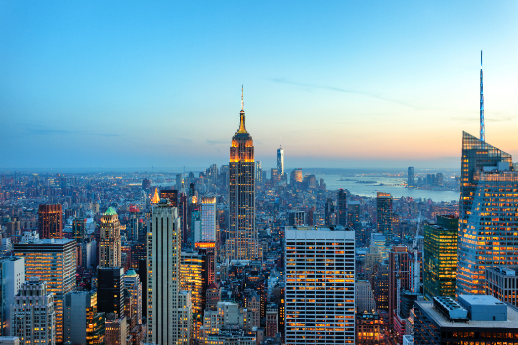 Manhattan-panorama-with-its-skyscrapers-illuminated-at-dusk,-New-York-Small